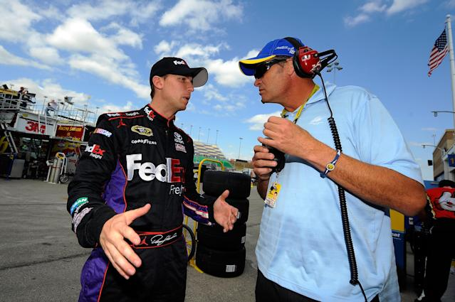KANSAS CITY, KS - OCTOBER 07: (L-R) Denny Hamlin, driver of the #11 FedEx Freight Toyota, talks with team owner Michael Waltrip during practice for the NASCAR Sprint Cup Series Hollywood Casino 400 at Kansas Speedway on October 7, 2011 in Kansas City, Kansas. (Photo by Jason Smith/Getty Images for NASCAR)