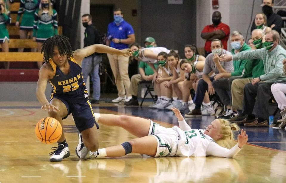 Keenan's MiLaysia Fulwiley (23) regains control of a ball swiped by Bishop England's Lily Woods (23) during the 3A state championship game at the USC Aiken Convocation Center on Friday, March 5, 2021.
