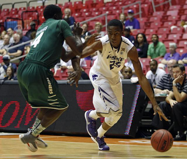 Charlotte guard Terrence Williams, left, pressures Kansas State forward Wesley Iwundu during a NCAA college basketball game in San Juan, Puerto Rico, Thursday, Nov. 21, 2013. (AP Photo/Ricardo Arduengo)