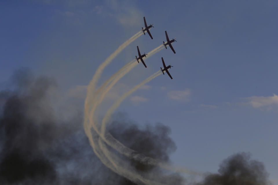 Israeli Air Force acrobatic team flies during a graduation ceremony for new pilots in Hatserim air force base near the southern Israeli city of Beersheba, Wednesday, Dec. 26, 2018. (AP Photo/Ariel Schalit)