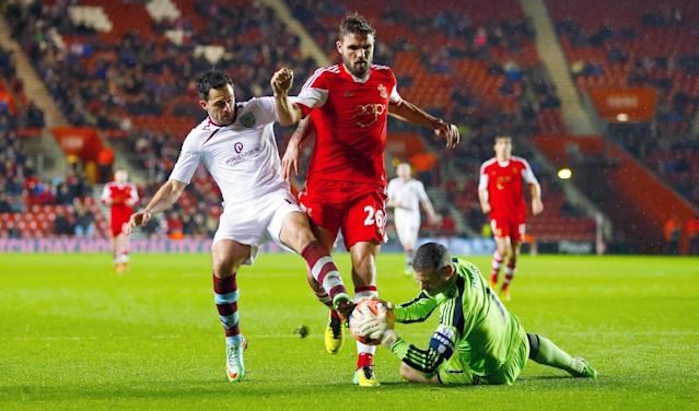 Southampton goalkeeper Kelvin Davis, right, stops the ball as Burnley's Danny Ings, left, and Southampton teammate Jos Hooiveld rush in during the FA Cup Third Round match at St Mary's, Southampton, England, Saturday, Jan. 4, 2014. (AP Photo/Chris Ison, PA Wire)