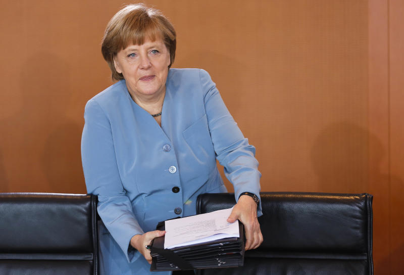 German Chancellor Angela Merkel arrives at the weekly cabinet meeting at the chancellery in Berlin on Wednesday, May 23, 2012. A new poll finds support for Chancellor Angela Merkel's conservatives has fallen after an embarrassing election defeat in Germany's most populous state. (AP Photo/Markus Schreiber)