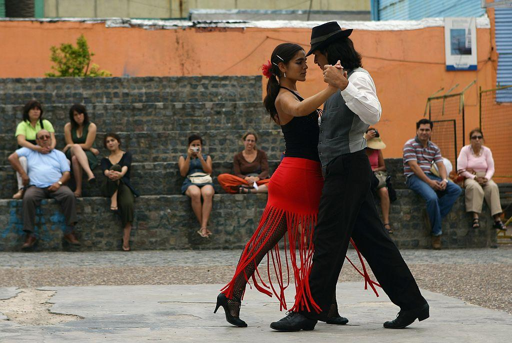 A couple dance to tango music, Tango was born in the suburbs of Buenos Aires.