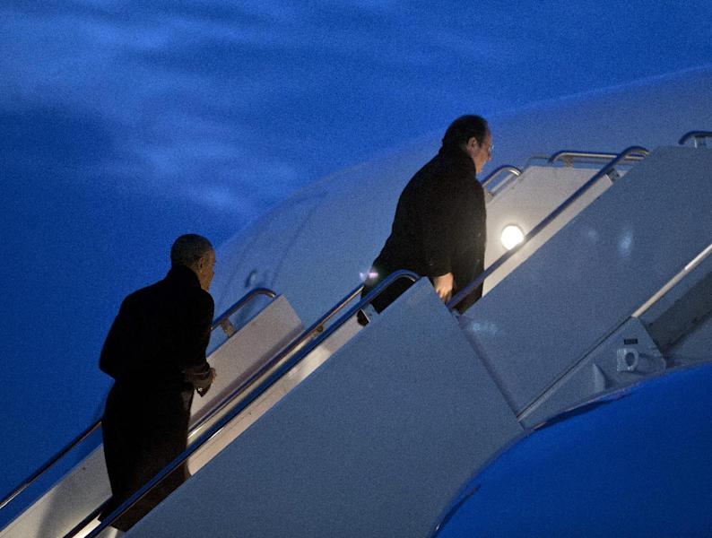 President Barack Obama, left, and French President Francois Hollande, right, board Air Force One during their departure from Charlottesville Albemarle Airport, Monday, Feb. 10, 2014, in Charlottesville, Va. Both leaders traveled to the region to tour Monticello, President Thomas Jefferson's estate, ahead of tomorrow's State Dinner. (AP Photo/Pablo Martinez Monsivais)