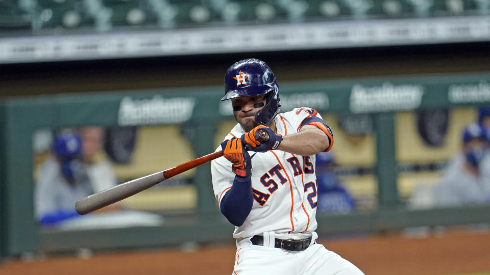 Houston Astros' Jose Altuve bats against the Los Angeles Dodgers during the third inning of a baseball game Wednesday, July 29, 2020, in Houston. (AP Photo/David J. Phillip)