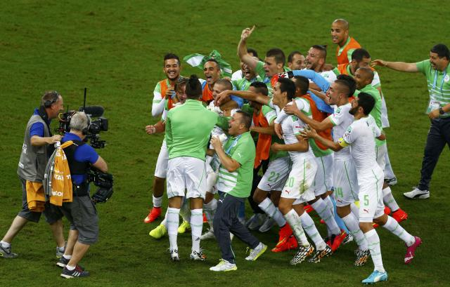 Algeria's national soccer team celebrates in front of the camera after their 2014 World Cup Group H soccer match against Russia at the Baixada arena in Curitiba June 26, 2014. REUTERS/Amr Abdallah Dalsh (BRAZIL - Tags: SOCCER SPORT WORLD CUP TPX IMAGES OF THE DAY)