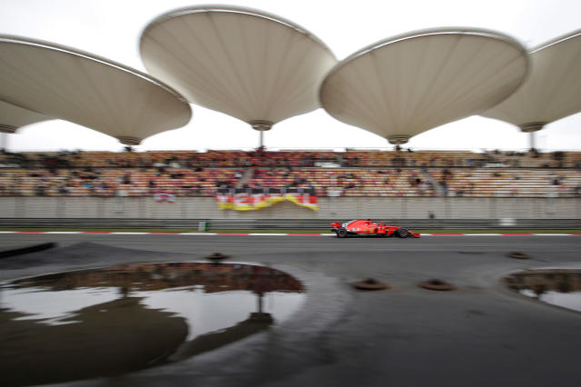 """FILE - In this April 14, 2018 file photo, Ferrari driver Sebastian Vettel of Germany steers his car during the third practice session for the Chinese Formula One Grand Prix at the Shanghai International Circuit in Shanghai. More Formula One races are coming to Asia, and a street race in the Vietnamese capital Hanoi could be the first addition. Formula One's managing director of commercial operations tells The Associated Press that Hanoi could be added for the 2020 season, though there has been some speculation it could arrive as early as next season. Sean Bratches says a second race in China is also likely and would join Shanghai. He says deciding where will """"be left to local Chinese partners."""" (AP Photo/Andy Wong, File)"""