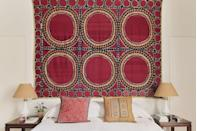 """<p>""""I love this room, it feels calming but warm, probably because of the textiles and the embroidered cushions. The Suzani over the bed is one of my favourites.""""</p>"""