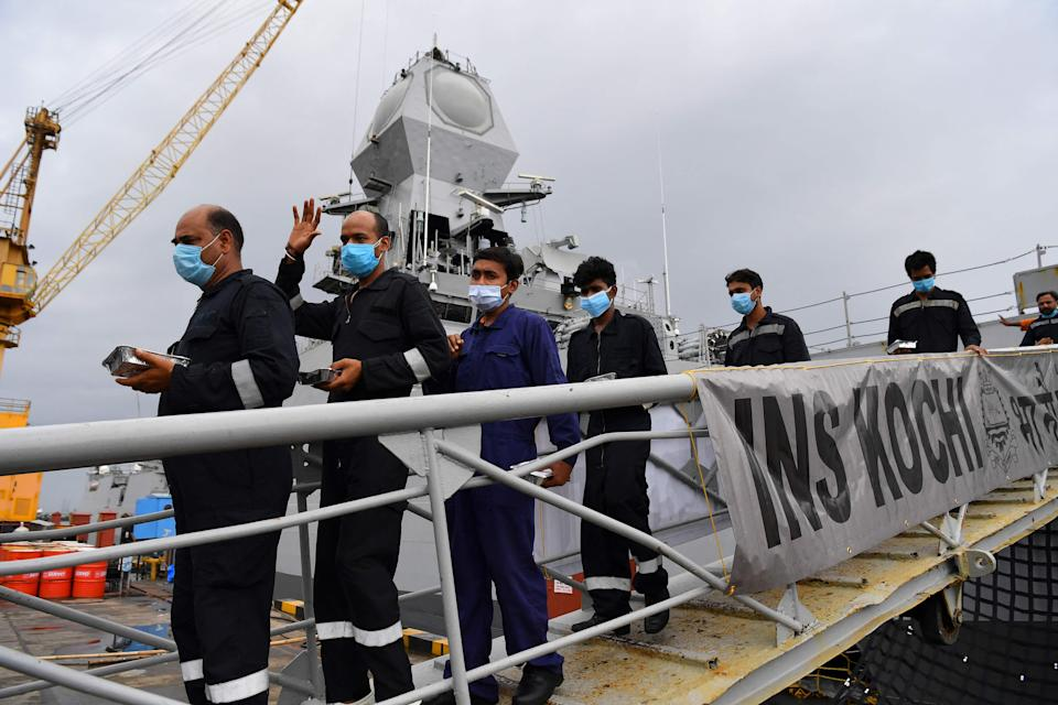<p>Rescued crew members from the sunken barge P305 disembark after arriving in Mumbai on 19 May 2021</p> (AFP via Getty Images)