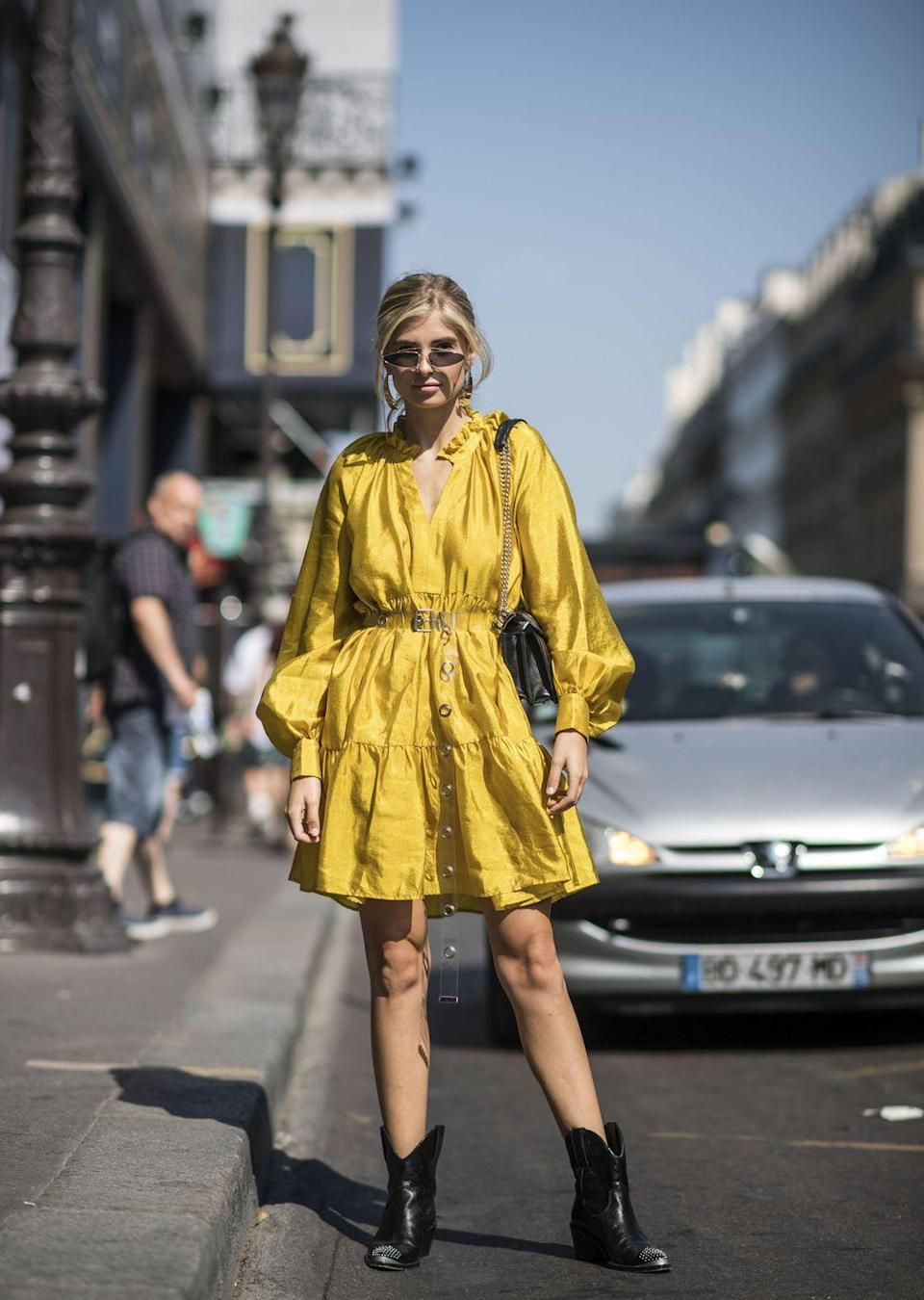 <p>Get a head start on fall's Western trend by styling a pair of cowboy ankle boots with a long-sleeved dress.</p>