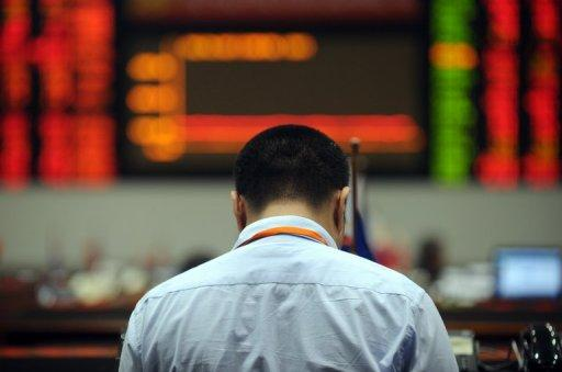 A trader works at the Manila Stock Exchange