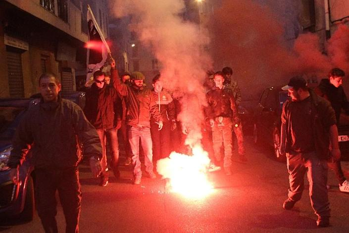 Demonstrators march towards the prefecture in Ajaccio during a protest on December 26, 2015 (AFP Photo/Yannick Graziani)