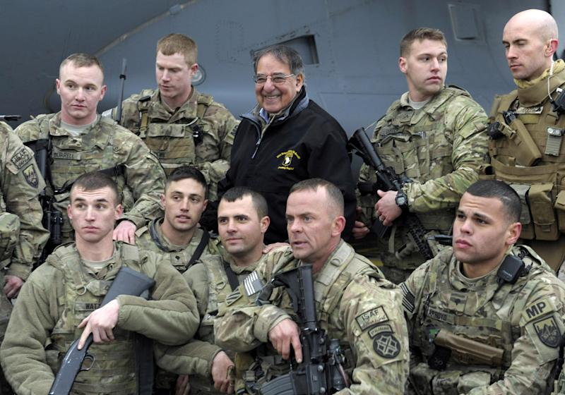 FILE - In this Dec. 14, 2012, photo, U.S. Defense Secretary Leon Panetta poses for a photo with troops at Kabul International Airport in Kabul, Afghanistan. U.S. commanders are offering glowing reviews of their 2012 Afghanistan war campaign. And the upbeat assessments that could be interpreted as leeway for President Barack Obama to order another round of troop withdrawals next summer.  Panetta has not yet recommended to Obama a specific pace of withdrawals for 2013. But during the Pentagon chief's two-day visit to the war zone last week, commanders suggested that things are going better than is generally believed by an American public weary of war after 11 years. (AP Photo/Susan Walsh, Pool)