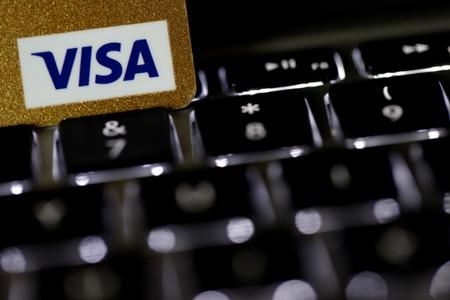A Visa credit card is seen on a computer keyboard in this picture illustration