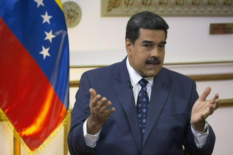 "FILE - In this Feb. 14, 2019 file photo, Venezuela's President Nicolas Maduro speaks during an interview at Miraflores presidential palace in Caracas, Venezuela. Maduro said Wednesday, Feb. 20, 2019, that 300 metric tons of high-cost medicines and aid was on its way from Russia.""We're not beggars,"" said Maduro. He insisted that Venezuela would pay for the aid and that it was coordinated with the support of United Nations' agencies. (AP Photo/Ariana Cubillos, File)"