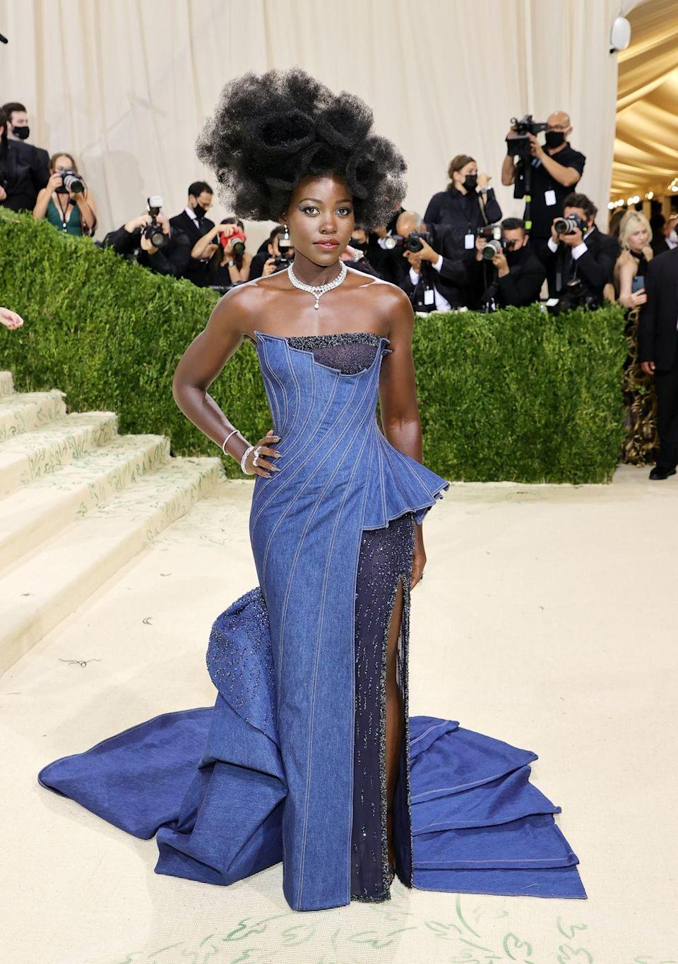 <p>It has been far too long since Lupita Nyong'o has graced the world's red carpet and to our utter delight, she came back to this one in gorgeously perfect style. The denim gown is about as American as style gets and the glorious swirl of hair takes the whole look somewhere new and interesting. </p>