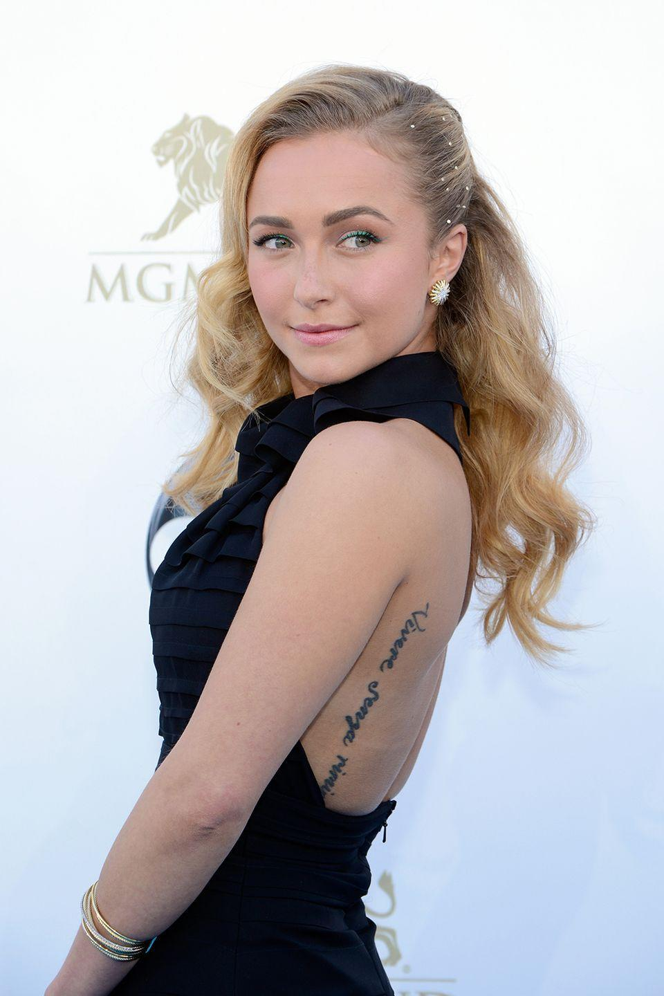 """<p>Hayden Panettiere's ink is ironic: She had the phrase, """"Live without regrets,"""" in Italian tattooed along the side of her back—unfortunately, she's got one regret now. In Italian the saying is, """"Vivere senza rimpianti,"""" but the last word was accidentally spelled, """"rimipianti.""""</p><p>""""It's misspelled, whatever,"""" she said <a href=""""http://www.dailymail.co.uk/tvshowbiz/article-2408535/Hayden-Panettiere-displays-partial-removal-misspelled-tattoo-Miami-beach-bikini.html"""" rel=""""nofollow noopener"""" target=""""_blank"""" data-ylk=""""slk:in an interview"""" class=""""link rapid-noclick-resp"""">in an interview</a>. """"I just put my own spin to it. Chances are I'll probably get it fixed, but that's why I love having it on my back because I don't get bored of it.""""</p>"""