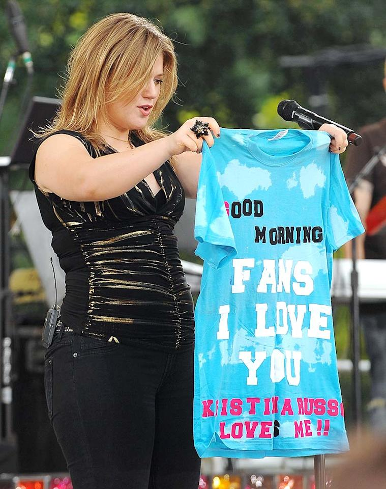 "The ""I Do Not Hook Up"" singer accepts a tacky homemade shirt from one of her biggest fans. Dimitrios Kambouris/<a href=""http://www.wireimage.com"" target=""new"">WireImage.com</a> - July 31, 2009"