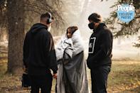 <p>Wife Katelyn bundles up on the set of the music video in Jackson Hole, Wyoming, where wildfires burned earlier this month.</p>