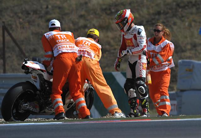Track marshals push the Honda motorcycle of Moto GP rider Hector Bautista of Spain after he fell during the free practice session at the Czech Republic Grand Prix in Moto GP on August 24, 2012, in Brno ahead of the Grand prix on August 26. AFP PHOTO / MICHAL CIZEKMICHAL CIZEK/AFP/GettyImages