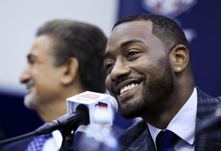 John Wall smiles at his news conference to announce his contract extension, with Wizards owner Ted Leonsis in the background. (Getty Images)