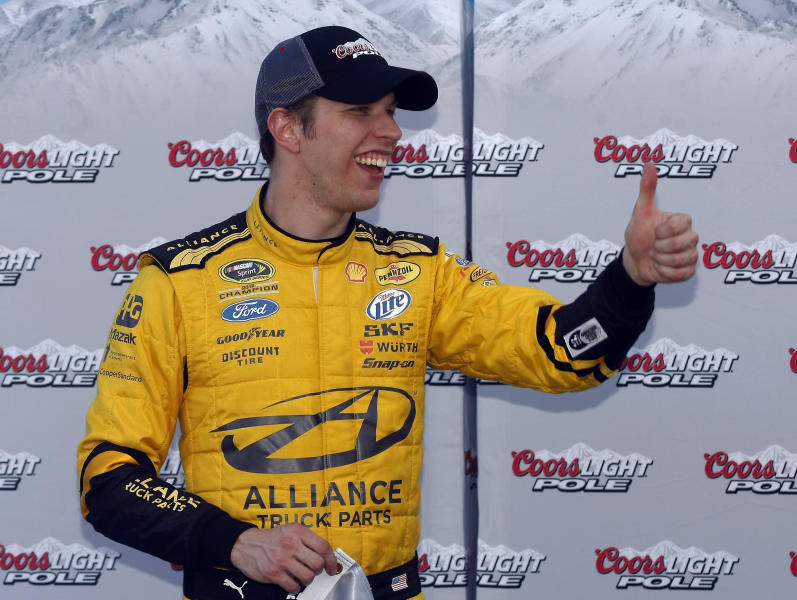 Brad Keselowski gives a thumb-up after winning the pole for Sunday's NASCAR Sprint Cup Series auto race on Friday, Feb. 28, 2014, in Avondale, Ariz. (AP Photo/Rick Scuteri)