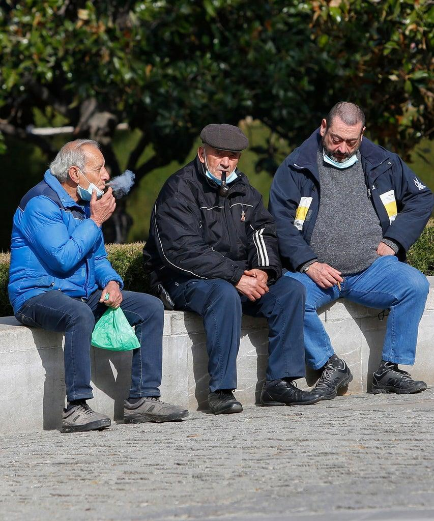 Editorial Use Only Mandatory Credit: Photo by Álex Cámara/NurPhoto/Shutterstock (11785718j) Three old men smoke with no face masks amid the coronavirus pandemic on March 04, 2021 in Granada, Spain. Daily Life in Granada amid the Covid-19 pandemic, Spain – 04 Mar 2021
