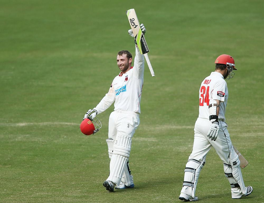 Phillip Hughes (L) of the Redbacks celebrates after reaching 200 runs during day three of the Sheffield Shield match between the Redbacks and the Warriors at Adelaide Oval on November 15, 2013 in Adelaide, Australia.  (Photo by Morne de Klerk/Getty Images)