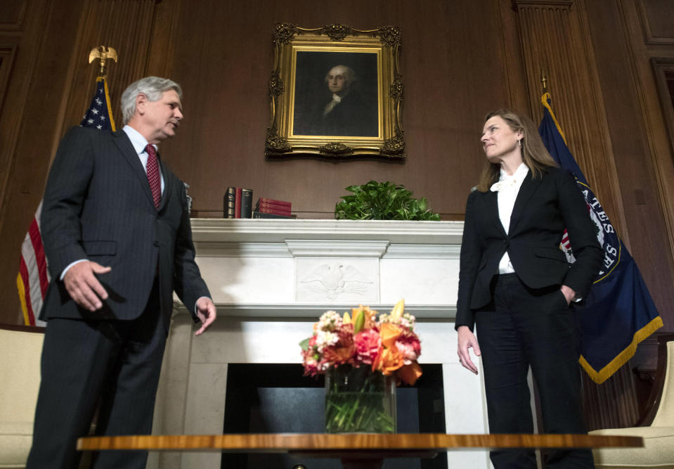 Supreme Court nominee Judge Amy Coney Barrett, meets with Sen. John Hoeven, N.D., Thursday, Oct. 1, 2020 at the Capitol in Washington. (Kevin Dietsch/Pool via AP)