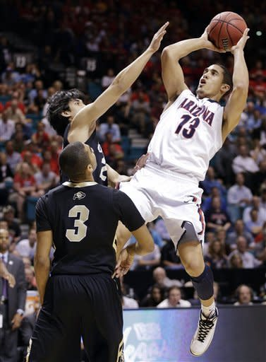 Arizona's Nick Johnson (13) shoots against Colorado's Sabatino Chen (23) and Xavier Talton in the first half during a Pac-12 tournament NCAA college basketball game, Thursday, March 14, 2013, in Las Vegas. (AP Photo/Julie Jacobson)