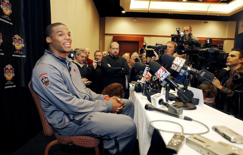 Auburn's Cam Newton smiles as he answers questions during an NCAA college football news conference Wednesday, Jan. 5, 2011, in Scottsdale, Ariz.  Auburn is scheduled to play Oregon in the BCS Championship football game on Monday, Jan. 10, in Glendale, Ariz. (AP Photo/Ross D. Franklin)