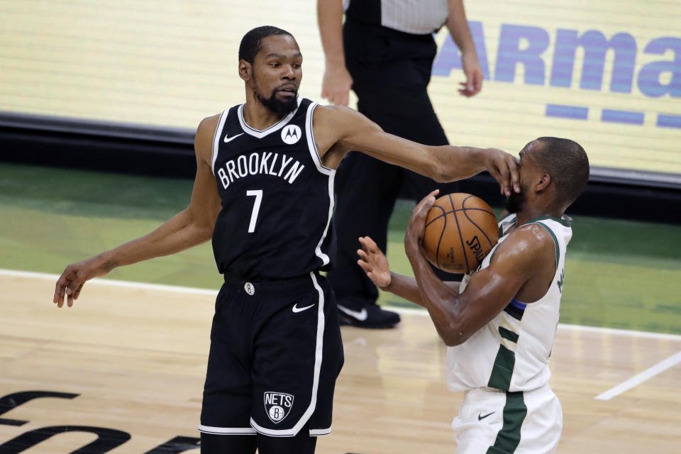 Milwaukee Bucks' Khris Middleton, right, steals the ball from Brooklyn Nets' Kevin Durant (7) during the second half of an NBA basketball game Tuesday, May 4, 2021, in Milwaukee. (AP Photo/Aaron Gash)