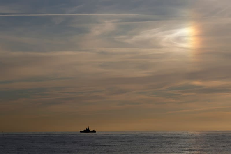 A coast guard boat patrols along the French coast in Wimereux