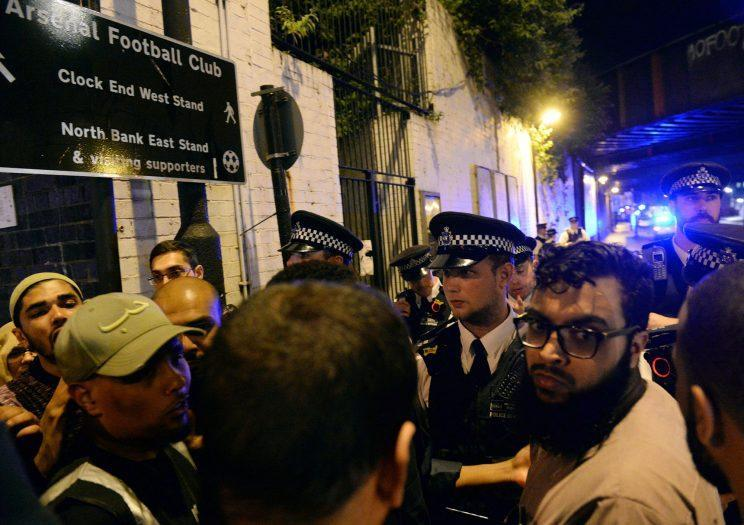 Police officers talk with local people at the Finsbury Park in north London, where a vehicle struck pedestrians Monday, June 19, 2017. A vehicle struck pedestrians near a mosque in north London early Monday morning, causing several casualties, police said. (Yui Mok/PA via AP)