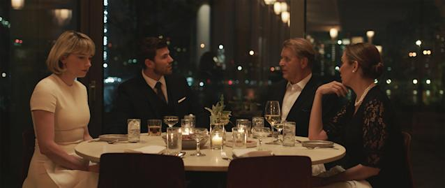 Hunter has a lonely dinner with her husband (Austin Stowell) and in-laws (David Rasche and Elizabeth Marvel) in <em>Swallow</em>. (Photo courtesy IFC Films)