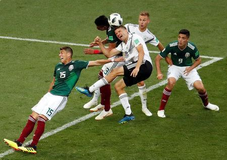 Soccer Football - World Cup - Group F - Germany vs Mexico - Luzhniki Stadium, Moscow, Russia - June 17, 2018 Germany's Thomas Muller and Joshua Kimmich in action with Mexico's Hector Moreno, Raul Jimenez and Jesus Gallardo REUTERS/Christian Hartmann