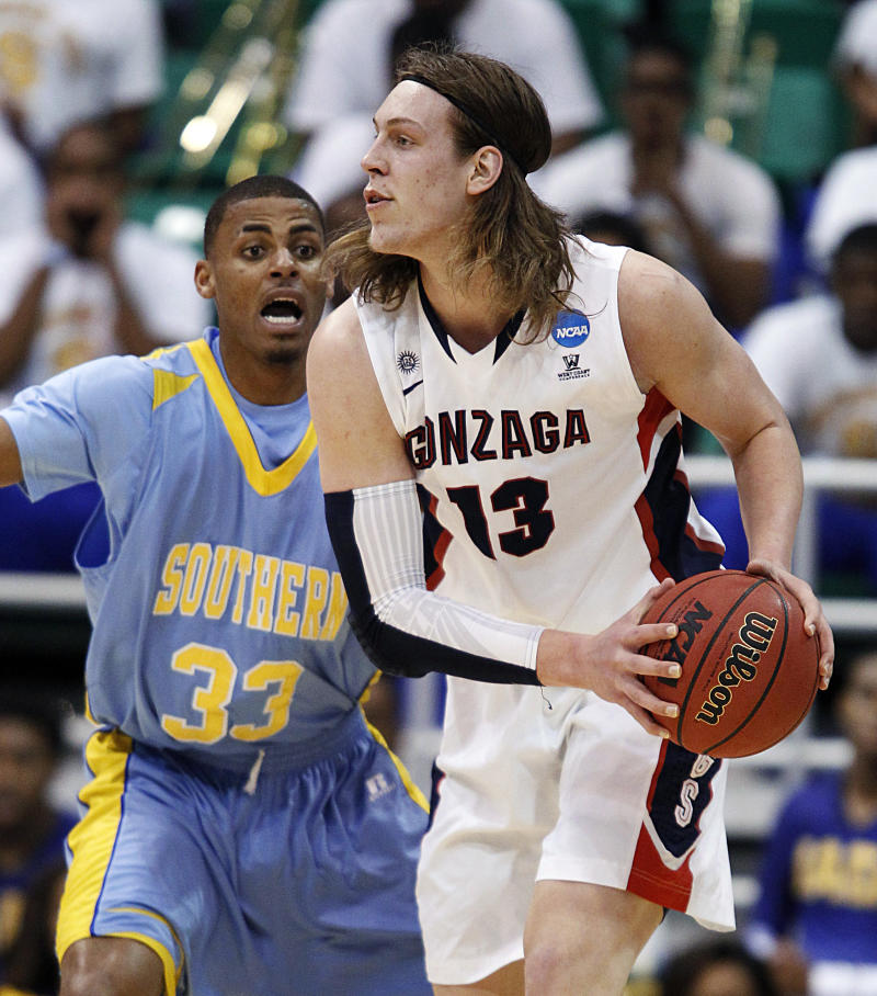 Gonzaga's Gonzaga's Kelly Olynyk, right, looks to pass as  Southern University's Malcolm Miller defends in the first half during a second-round game in the NCAA college basketball tournament in Salt Lake City, Thursday, March 21, 2013. (AP Photo/George Frey)