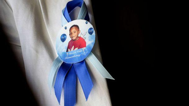 PHOTO: In this Tuesday, Aug. 14, 2018 photo taken in Houston, a pin on the lapel of Dikeisha Whitlock-Pryer's jacket shows a photo of her son, Raymond Pryer Jr. (Elizabeth Conley/AP Photo)