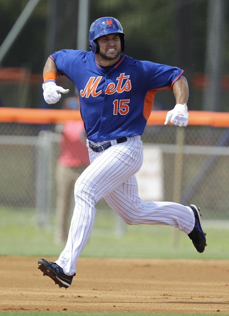 <p>Tim Tebow reacts after hitting a solo home run in his first at bat during the first inning of his first instructional league baseball game for the New York Mets against the St. Louis Cardinals instructional club Wednesday, Sept. 28, 2016, in Port St. Lucie, Fla. (AP Photo/Luis M. Alvarez) </p>