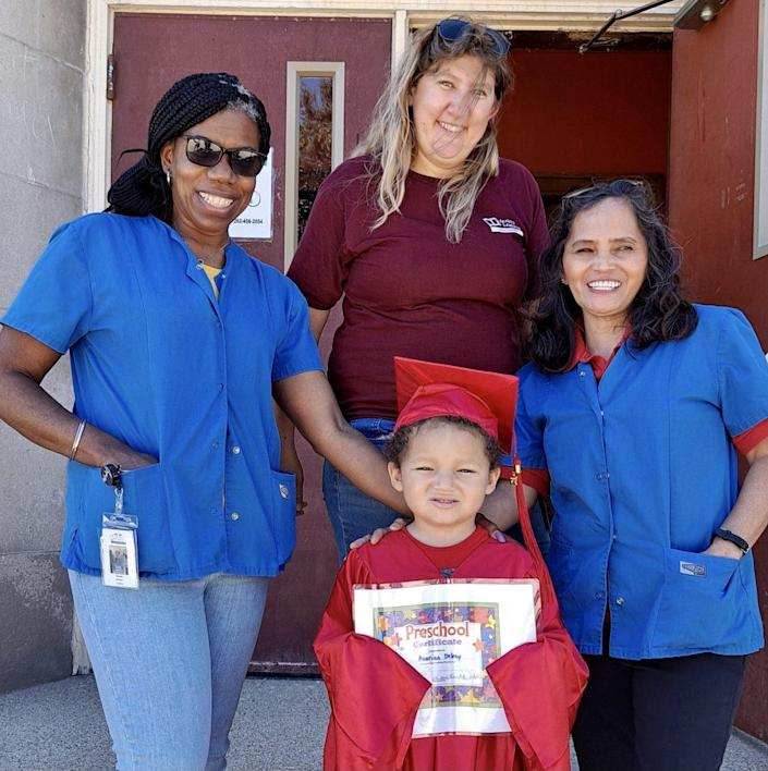 Five-year-old Avarian Delray with teachers Wanda Brown (L-R), Heidi Hoefs and and Lalaine Ratz at Acelero Learning in Racine, Wisconsin. (Sharon Larson)