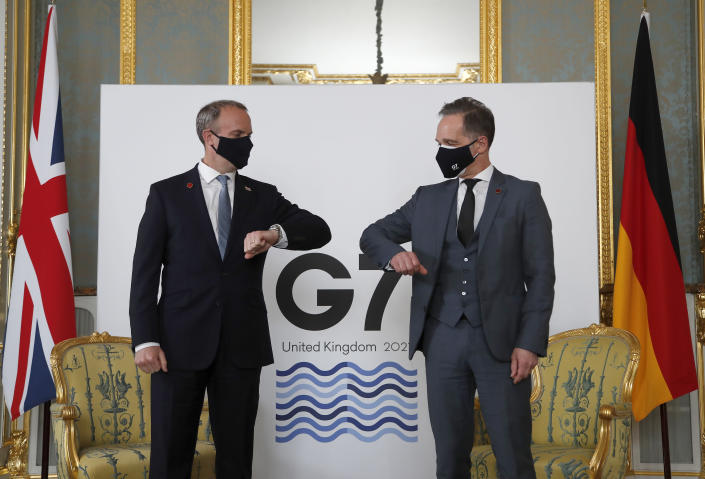Britain's Foreign Secretary Dominic Raab, left, poses for a photo with his German counterpart Heiko Maas ahead of bi-lateral talks during the G7 foreign ministers' meeting in London, Wednesday, May 5, 2021. Diplomats from the group of wealthy nations are meeting in London for their first face-to-face gathering in two years. (AP Photo/Frank Augstein, Pool)