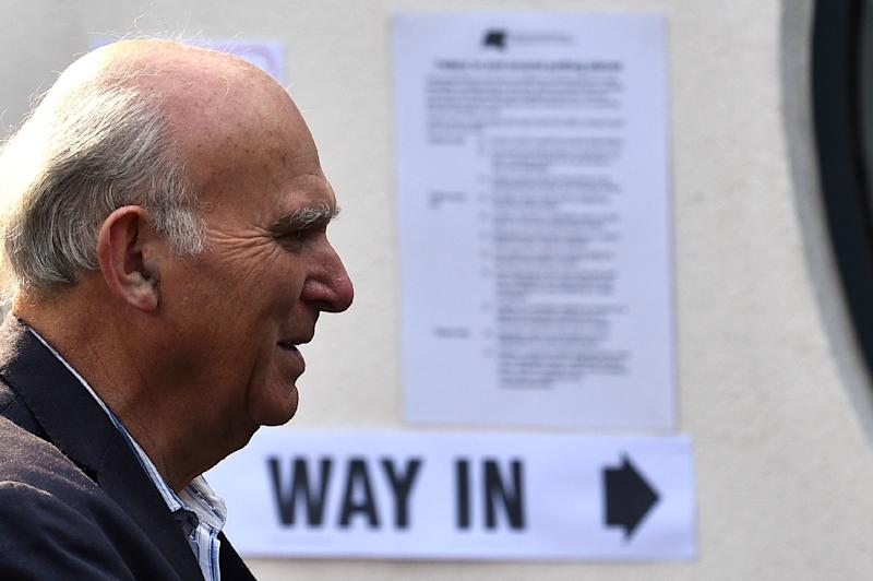 Liberal Democrats leader Vince Cable arrives to vote in the European Parliament elections on Sunday which preliminary results later showed his party winning the anti-Brexit vote
