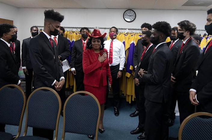 Congresswoman Frederica Smith Wilson among students during the 5000 Role Model of Excellence Foundation 2021 Wilson Scholars academic signing ceremony at Jesus People Ministries Church International in Miami Gardens on Sunday, June 27, 2021.