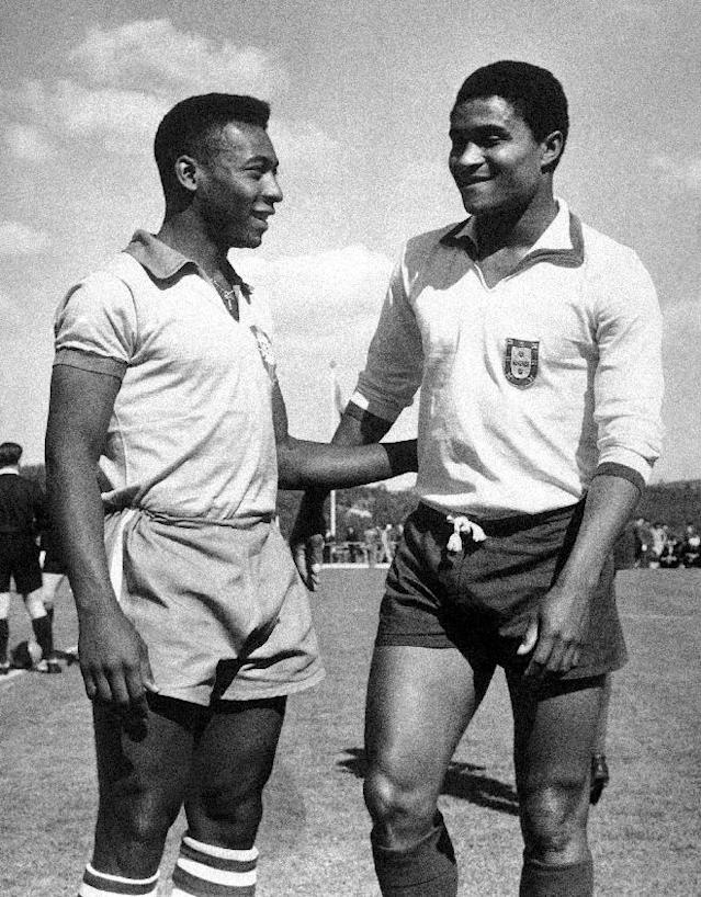 FILE - In this April 27, 1963 file photo, Brazilian footballer Edson Arantes do Nascimento, known as Pele, left, enjoys a chat with Eusebio da Silva Ferreira in Lisbon, Portugal. Eusebio, the Portuguese football star who was born into poverty in Africa but became an international sporting icon and was voted one of the 10 best players of all time, has died of heart failure aged 71, Sunday, Jan. 5 2014. (AP Photo, File)