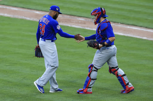 Chicago Cubs' Jeremy Jeffress, left, celebrates with Victor Caratini, right, in the seventh inning during a baseball game against the Cincinnati Reds in Cincinnati, Saturday, Aug. 29, 2020. (AP Photo/Aaron Doster)