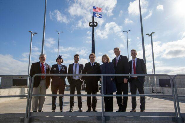 With Rocket Lab CEO Peter Beck at center, dignitaries gather at Launch Complex 2 at the Mid-Atlantic Regional Spaceport on Virginia's Wallops Island. (NASA Wallops Photo)