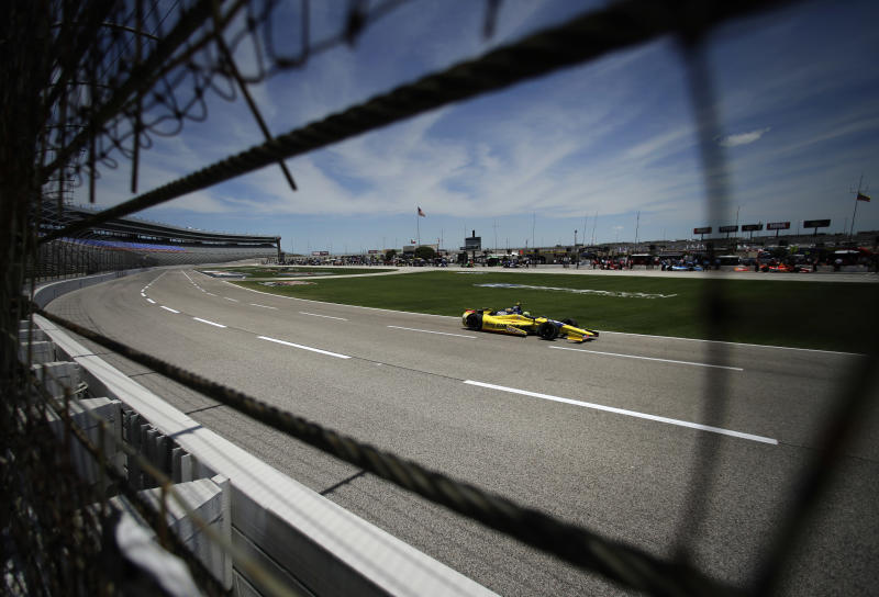 Tony Kanaan, of Brazil, heads down the front stretch during a practice session for Saturday's IndyCar auto race at Texas Motor Speedway Friday, June 7, 2013, in Fort Worth, Texas. (AP Photo/Tony Gutierrez)