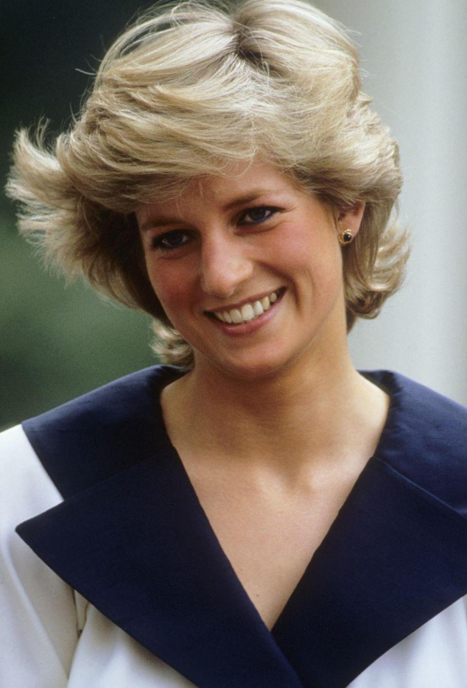 <p>Princess Diana at the Queen Mother's 87th birthday celebrations on August 4, 1987 wearing an oversized navy notch collar.</p>