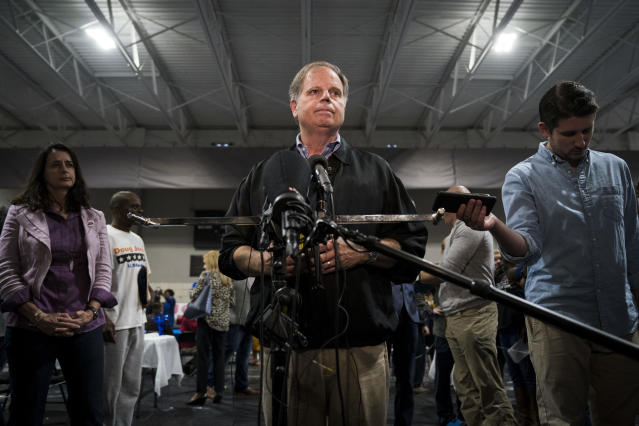 Democratic U.S. Senate candidate Doug Jones takes questions from reporters at a fish-fry campaign event Nov. 18 in Birmingham, Ala. (Photo: Drew Angerer/Getty Images)