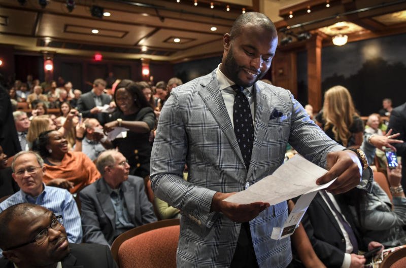 "TALLAHASSEE, FL - MACRH 17: Myron Rolle opens his ""Match Day"" letter that shows where he will continue his medical education and residency on Friday, March 17, 2017. Rolle is a former NFL player and Rhodes Scholar. (Photo by Toni L. Sandys/The Washington Post via Getty Images)"
